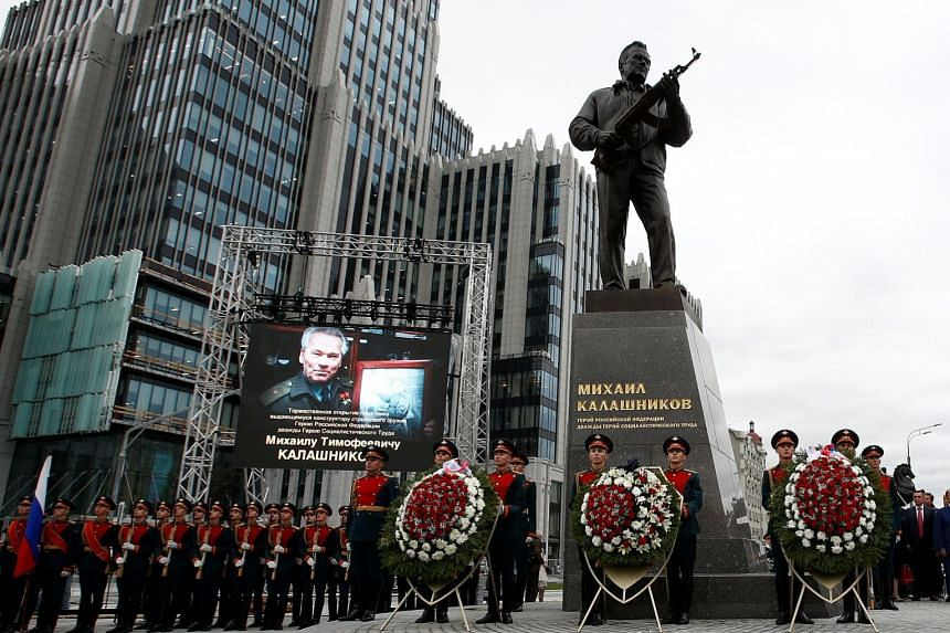 A monument to Mikhail Kalashnikov - designer of the AK-47 rifle that has become the world's most common assault weapon - was unveiled on Tuesday in Moscow. The bronze statue depicts Kalashnikov, who died in 2013 at age 94, holding one of his weapons