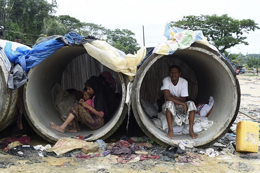 Rohingya Muslim refugees sheltering in cement pipes at Kutupalong refugee camp in the Bangladeshi district of Ukhia yesterday. Myanmar leader Aung San Suu Kyi on Tuesday condemned rights abuses in Rakhine state, where conflict that began last month h