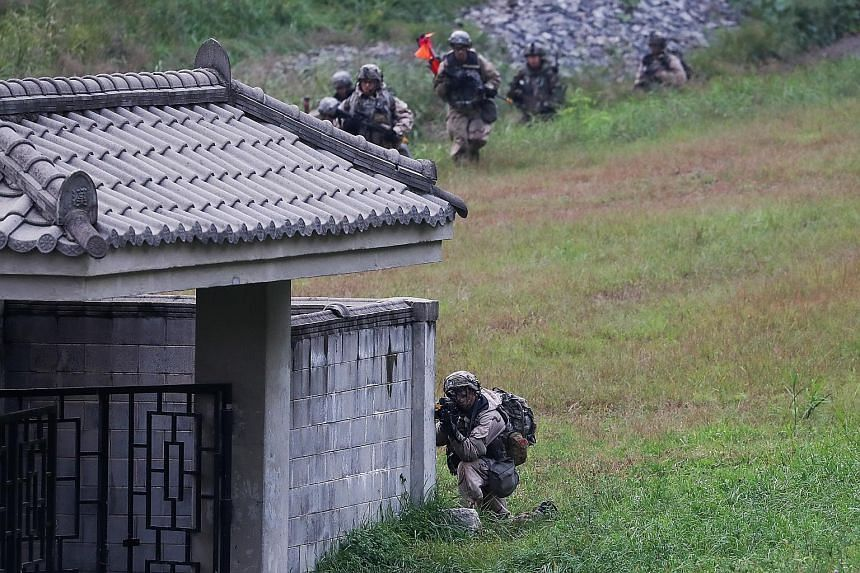 A US Army soldier taking aim during a bilateral training exercise with the South Korean army in Paju, South Korea, on Tuesday. Mr Donald Trump and Mr Shinzo Abe at a luncheon hosted by United Nations Secretary-General Antonio Guterres in New York on
