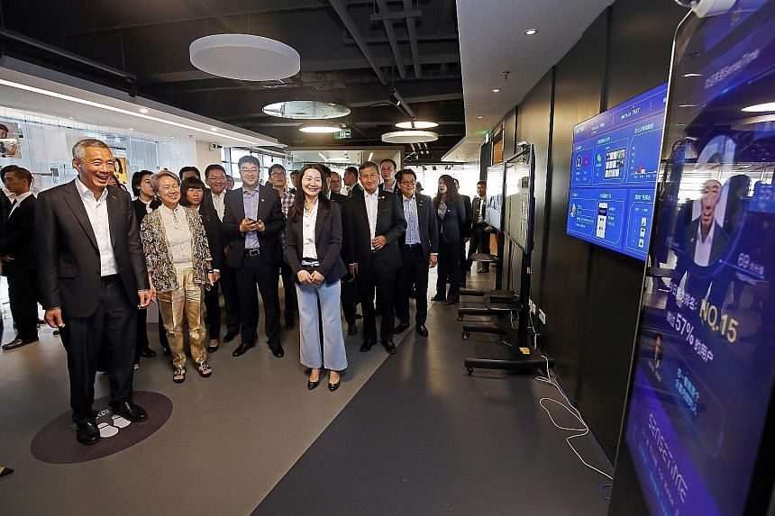 Prime Minister Lee Hsien Loong and Mrs Lee on a tour of Chinese technology firm SenseTime in Beijing yesterday, where he tried out a system which uses facial recognition to determine the gender, age and current mood of a person. The result is used to