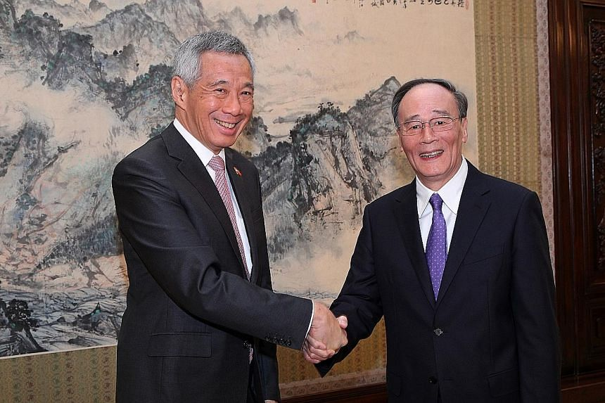 Prime Minister Lee Hsien Loong meeting Mr Wang Qishan, head of the CCP's Central Commission for Discipline Inspection, at the Zhongnanhai leadership compound in Beijing yesterday.