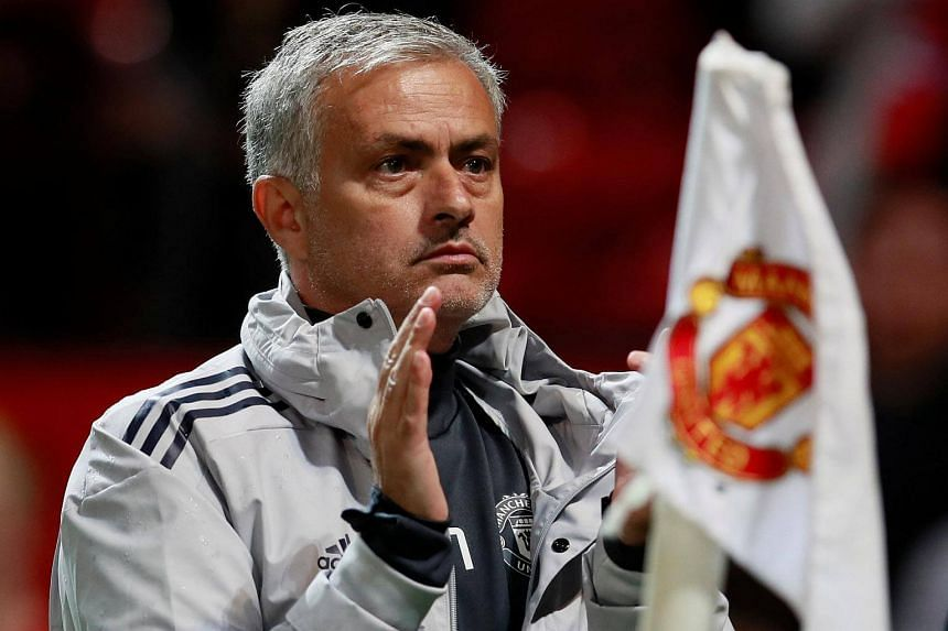 Jose Mourinho applauds fans after the League Cup match between Manchester United and Burton Albion.