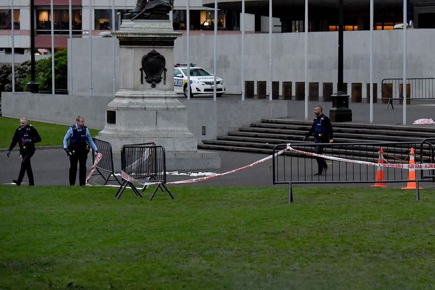 Police officers cordoning off the area where a lone protester set himself on fire outside New Zealand's Parliament in Wellington, on Sept 21, 2017.