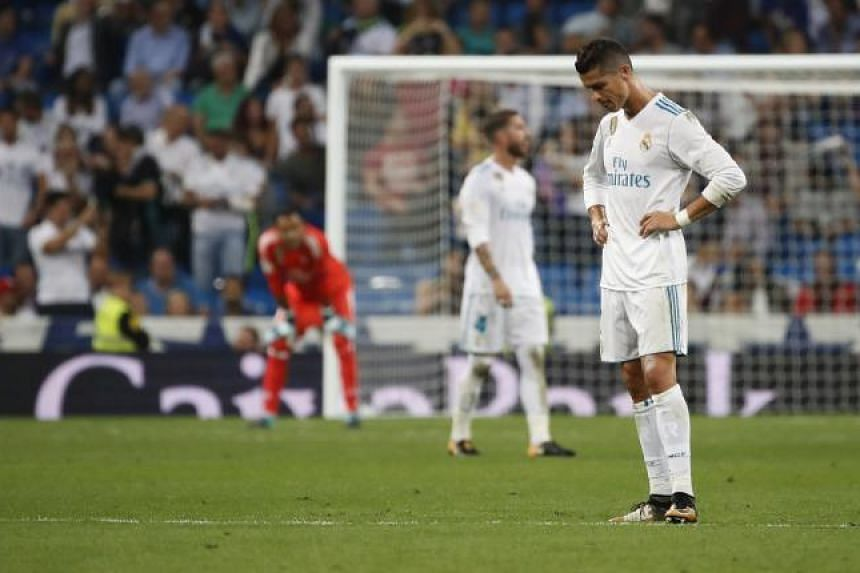 Cristiano Ronaldo (right) reacts after Real Betis scored a late goal during their Spanish Liga Primera Division football match.
