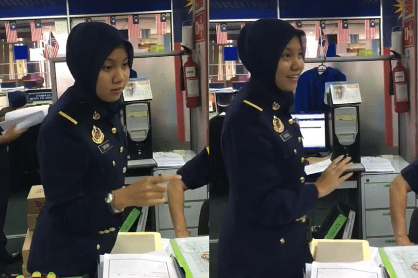 Ms Nur Syafiqah Azaman was seen explaining to two Chinese nationals the procedure for a car ownership transfer.