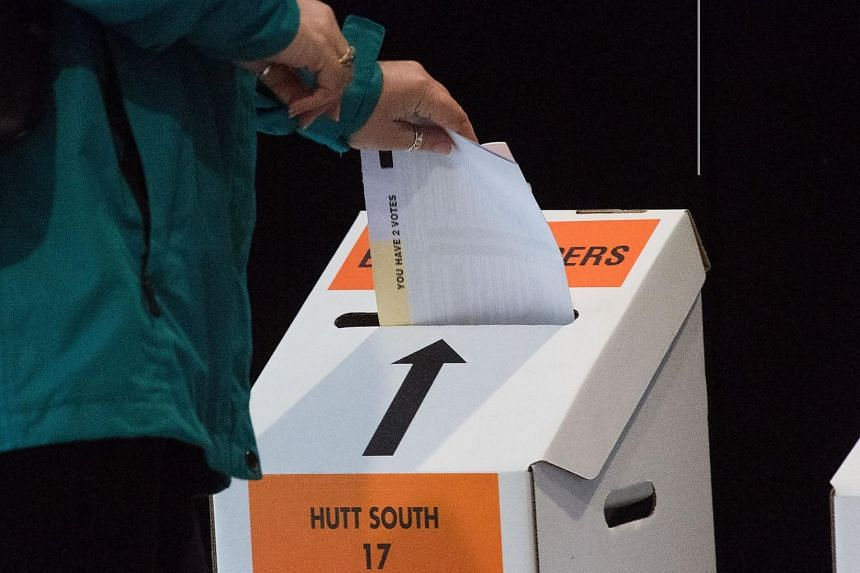A woman casts her vote for the 2017 general election in Wellington on Sept 21, 2017.