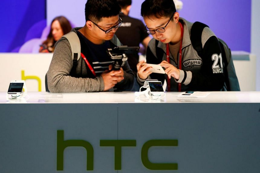 Attendees view the new HTC U Ultra at the HTC stand at the Mobile World Congress in Barcelona.