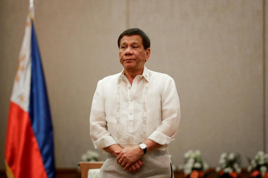Philippines' President Rodrigo Duterte stands at attention during a courtesy call with the Association of Southeast Asian Nations (Asean) Economic Ministers in Manila, on Sept 6, 2017.