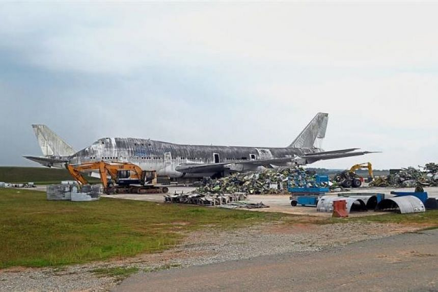 One of the Boeing jets being demolished at the Senai International Airport following the auction.