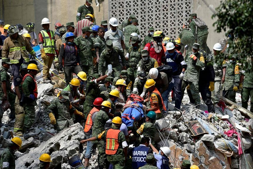 A man is pulled out of the rubble alive in Mexico City on Sept 20, 2017.
