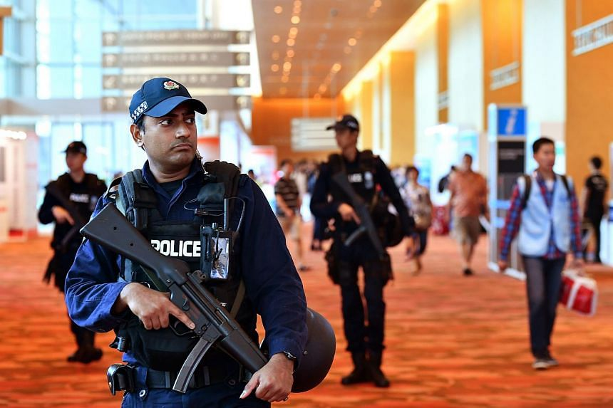 Security personnel patrolling the Marina Bay Sands Expo and Convention Centre area.