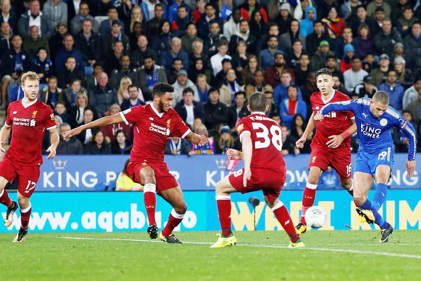 Leicester City's Islam Slimani scores their second goal in the 2-0 League Cup defeat of Liverpool on Tuesday. Jurgen Klopp's men had 70 per cent possession but the Foxes were inspired by Shinji Okazaki coming on as a substitute.