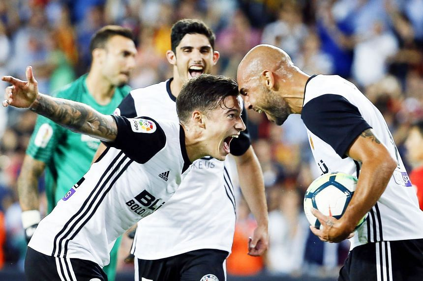 Italian striker Simone Zaza (right) celebrating his hat-trick against Malaga with team-mate Santi Mina. Valencia have endured two tumultuous seasons in a row but it appears the Spanish sleeping giants are awakening.