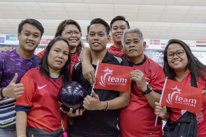 S'pore bowler Muhammad Farhan Ismail with his family after winning the TPB4 gold at the APG. He bowls with his family occasionally and also hits the lanes with his former schoolmates.