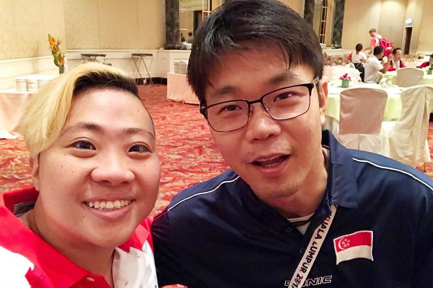 Theresa Goh with para-table tennis player Stanley Lim at the Kuala Lumpur Asean Para Games. Lim used to be a swimmer.