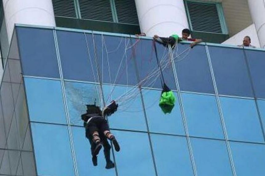 The strings of his parachute had got entangled at the 13th floor of the building, which kept him from falling.