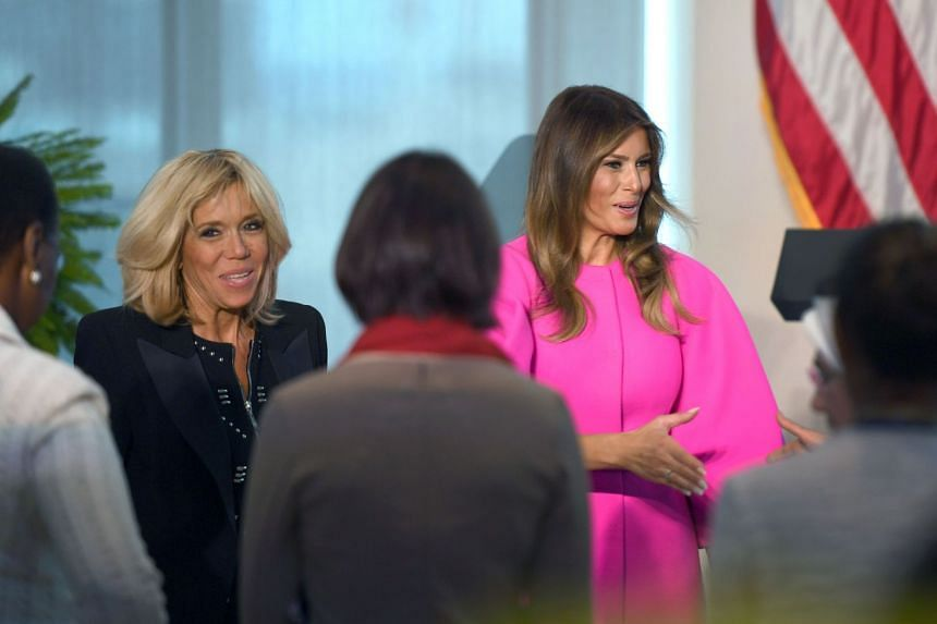 Melania Trump (right) and France's First Lady Brigitte Macron greet guests at the luncheon.