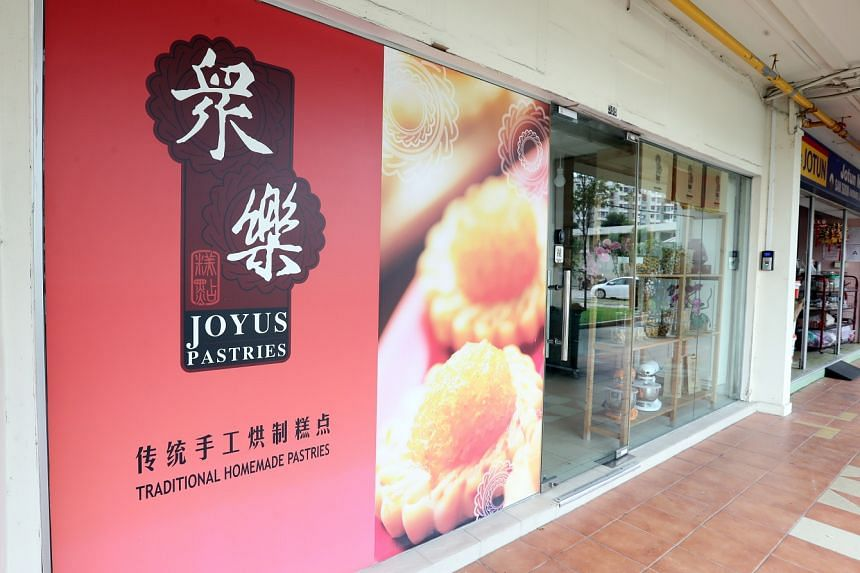 The woman had her right arm trapped in the mixer. The Ang Mo Kio outlet is closed until Nov 1.