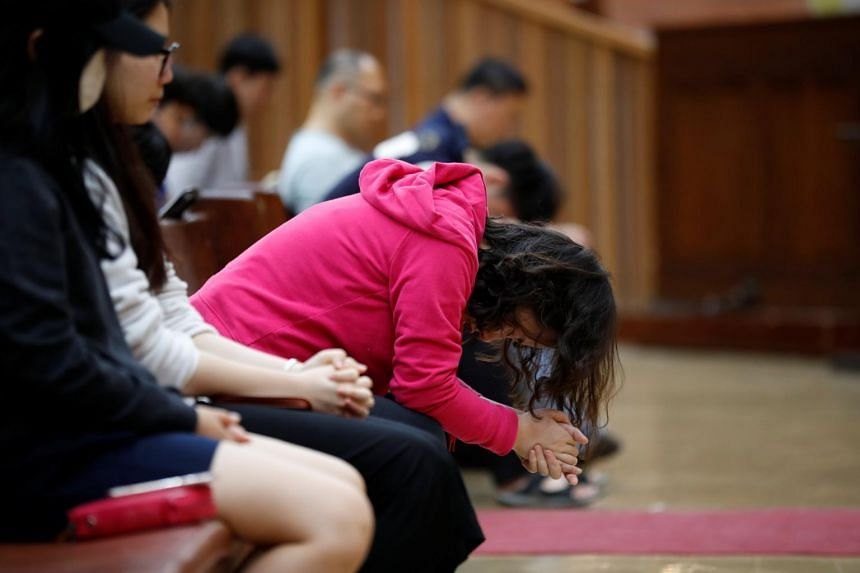 Students pray during an early-morning prayer session at the Presbyterian University and Theological Seminary (PUTS) in Seoul.