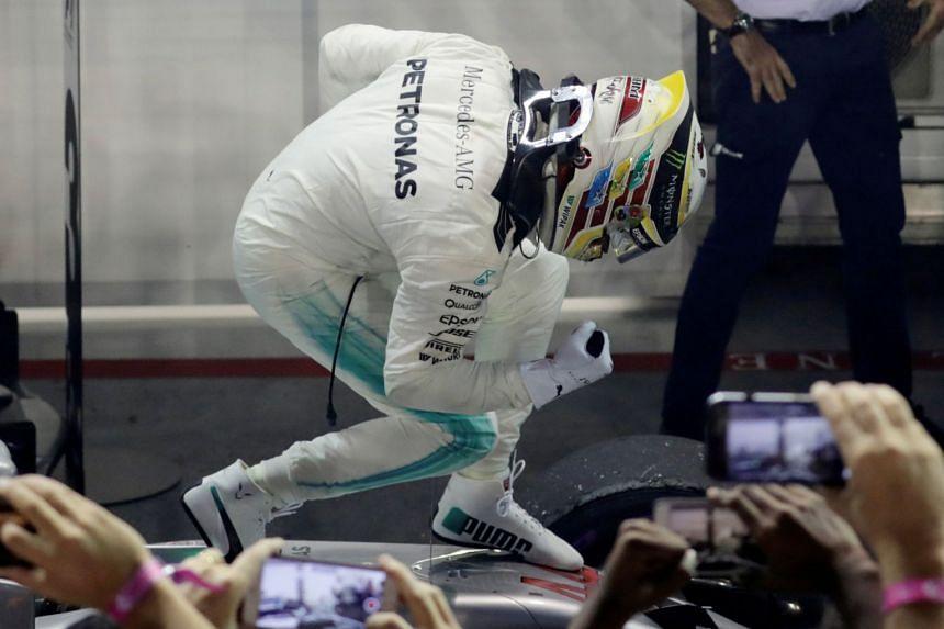 Lewis Hamilton celebrating his win in Singapore.