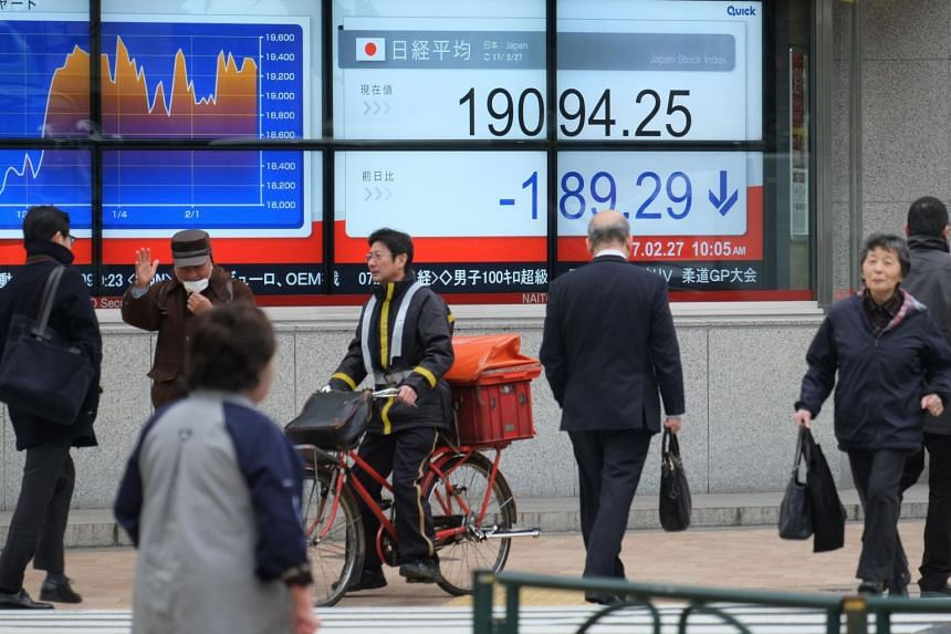 An electric quotation board flashing the Nikkei key index of the Tokyo Stock Exchange is displayed at a securities company in Tokyo.