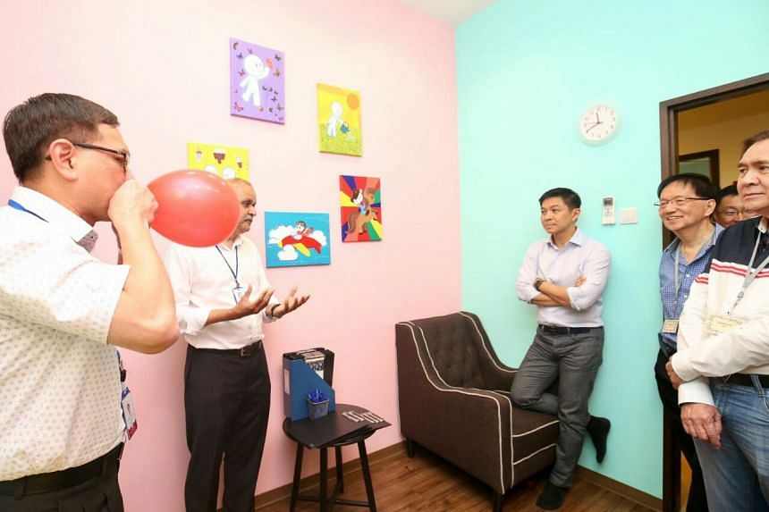 Speaker of Parliament Tan Chuan-Jin on a tour of the officially launched family support centre.