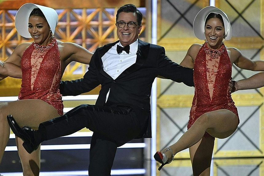 Emmys host Stephen Colbert performing during the 69th Emmy Awards on Sunday. Namie Amuro will retire in September next year on the 26th anniversary of her career.