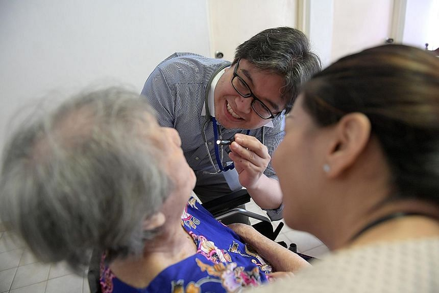 Dr Erwin Francisco, resident physician at Dover Park Hospice, and staff nurse Zhao Meijuan attending to Mrs Monica Fernandez in her own home. Since joining Programme Dignity last year, Mrs Fernandez and her daughter, who cares for her, have not neede