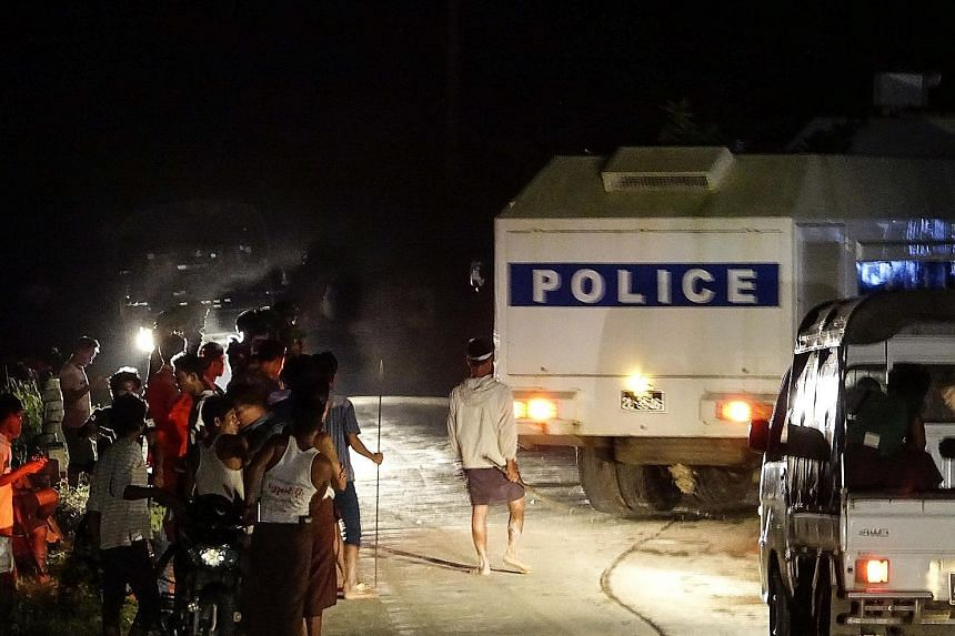 A Myanmar police vehicle at the dock in Sittwe where protesters, some armed with sticks and metal bars, threw petrol bombs to prevent Red Cross workers from loading a shipment of aid onto a boat bound for northern Rakhine. No aid workers were hurt du