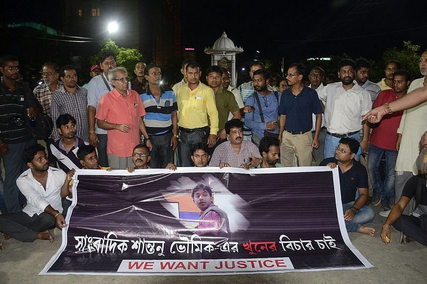 Indian journalists at a road blockade, set up over the killing of fellow reporter Shantanu Bhowmick on Wednesday, in front of the Chief Minister's residence in Agartala, the capital of the north-eastern state of Tripura.