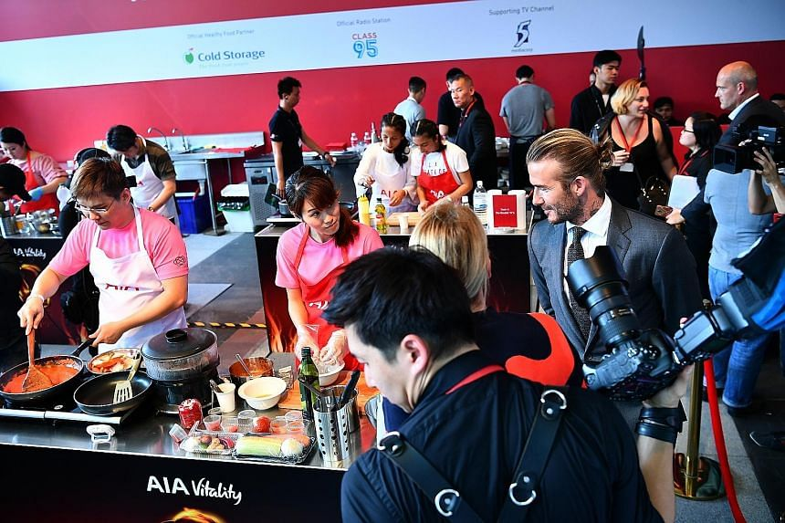 David Beckham meeting contestants at the AIA Vitality Healthy Cookout Showdown at Clifford Square to promote healthy eating for his sponsor. The former England captain had noodles, rice and chicken for lunch yesterday.