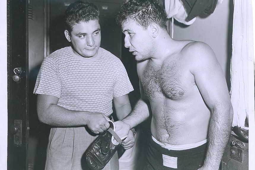 Jake LaMotta training in New York in 1949, the year he captured the middleweight championship. Six years earlier, he became the first man to defeat boxing great Sugar Ray Robinson.