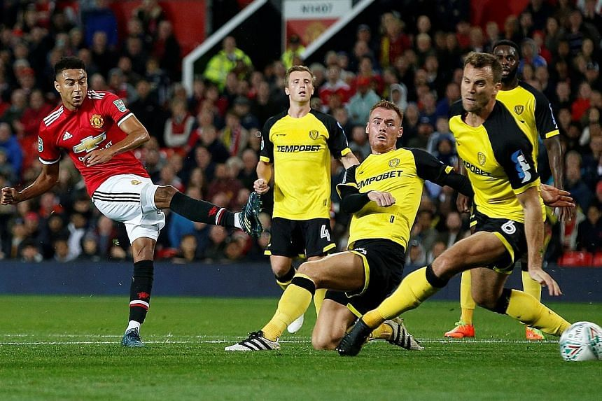 Manchester United's Jesse Lingard scoring his side's third goal during the League Cup third-round tie against Burton Albion on Wednesday. He started the match after manager Jose Mourinho made nine changes to his side.