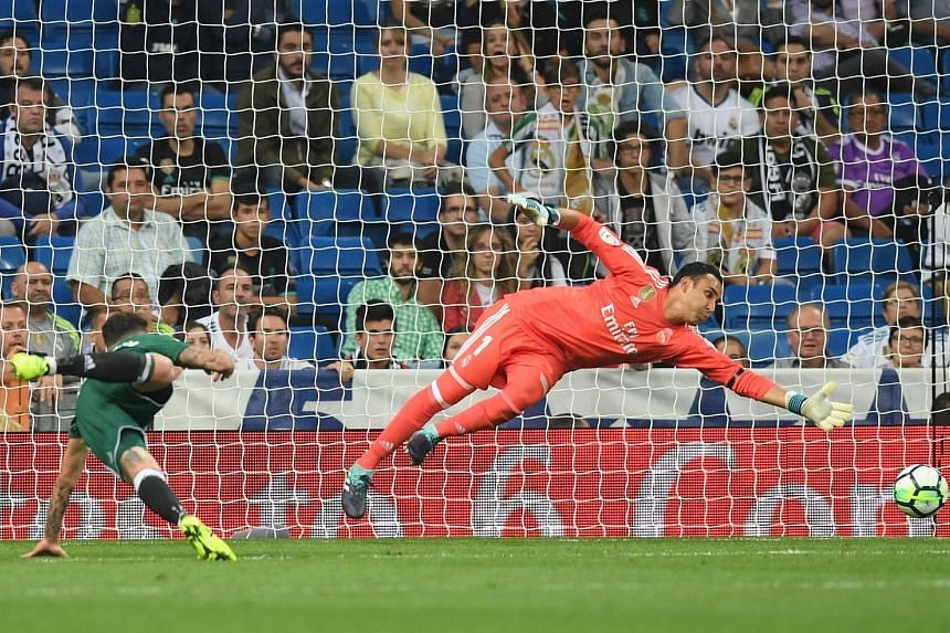 Real Betis forward Antonio Sanabria snatching all three points for his team after his header beat Real Madrid 'keeper Keylor Navas in the dying minutes of Wednesday's LaLiga match at the Santiago Bernabeu.
