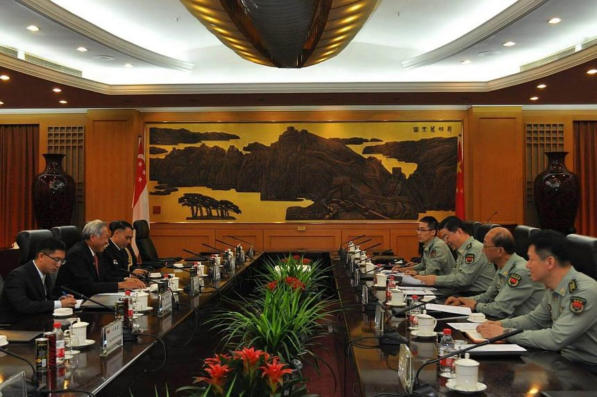Singapore's Defence Minister Ng Eng Hen in a discussion with Chinese defence counterparts in Beijing.