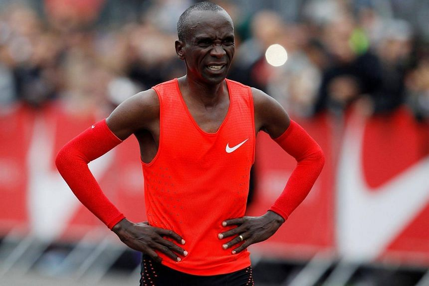 Kenyan Eliud Kipchoge reacts after crossing the finish line during an attempt to break the two-hour marathon barrier at the Monza circuit in Italy, on May 6, 2017.