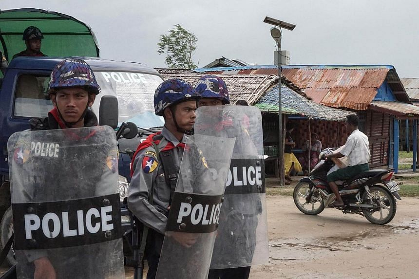 Myanmar police standing guard at an Internally Displaced Persons (IDPs) camp in Sittwe, Rakhine State, on Sept 1, 2017.