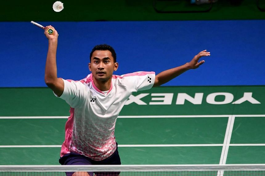 Tommy Sugiarto of Indonesia hits a return against Lee Chong Wei of Malaysia during their men's singles second round match at the Japan Open Badminton Championships in Tokyo, on Sept 21, 2017.