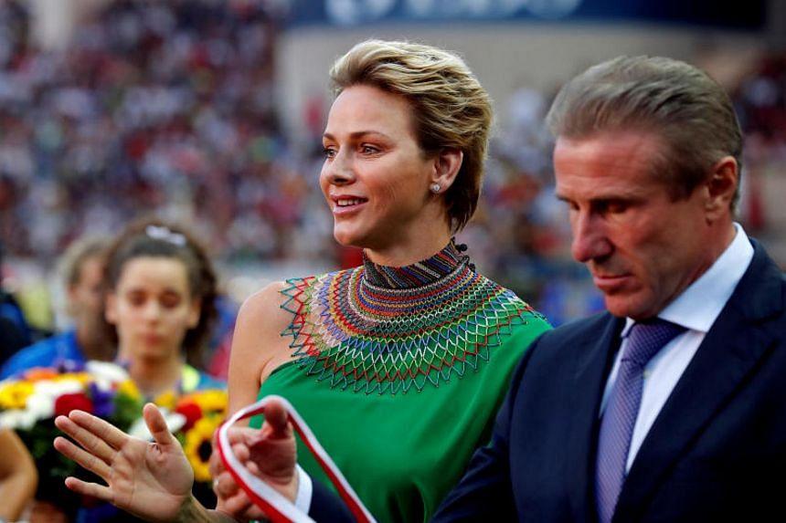 International Olympic Committee (IOC) member Sergey Bubka with Princess Charlene of Monaco at the IAAF Diamond League Herculis meeting at  Louis II Stadium on July 21, 2017.