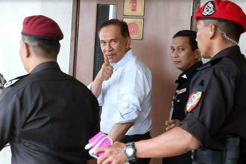 Datuk Seri Anwar Ibrahim being led away in tight security at the High Court in Kuala Lumpur in August 2016.