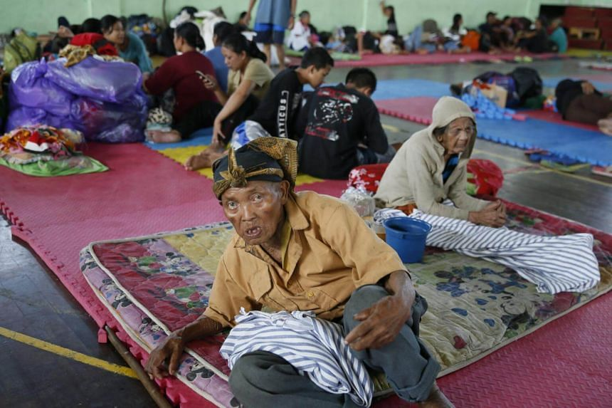 Residents stay at a temporary shelter as they evacuate following increasing seismic activity of Mount Agung in Karangasem, Bali, Indonesia, on Sept 22, 2017.