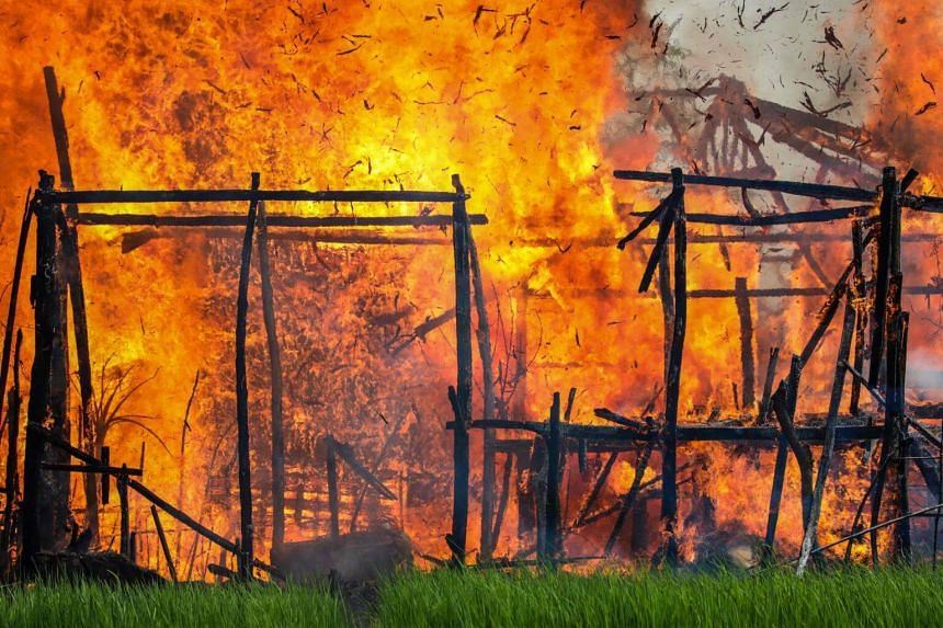 A house is engulfed by fire in Gawdu Tharya village near Maungdaw in Rakhine state in northern Myanmar on Sept 7, 2017.