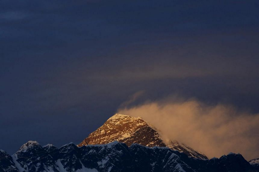 Light illuminates Mount Everest, during sunset in the Solukhumbu District also known as the Everest region, on Nov 30, 2015.