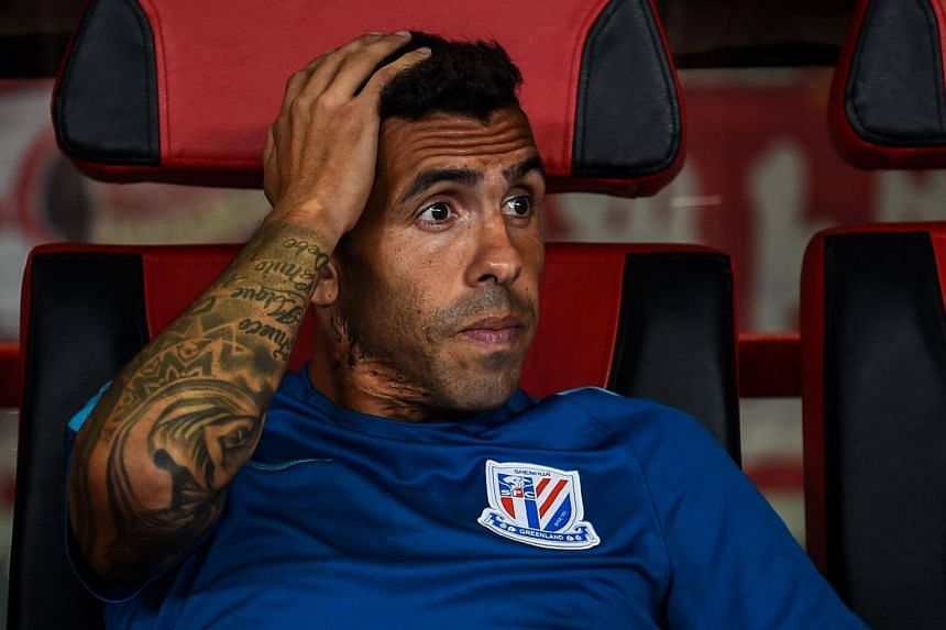 Shanghai Shenhua's Carlos Tevez looks on during the 2017 Chinese Super League football match between Shanghai East Asia (SIPG) FC and Shanghai Shenhua in Shanghai on Sept 16, 2017.