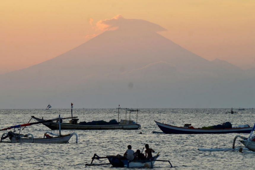 Mount Agung, an active volcano located on the resort island of Bali that has been placed on alert level 3 following recent seismic activity, is seen from Mataram on nearby Lombok island.
