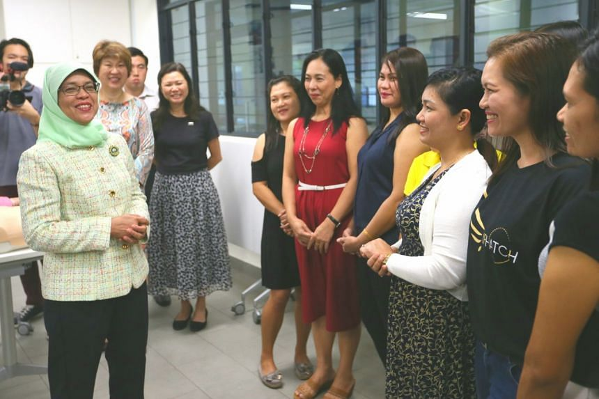 President Halimah Yacob interacts with foreign domestic workers at Agape Village.
