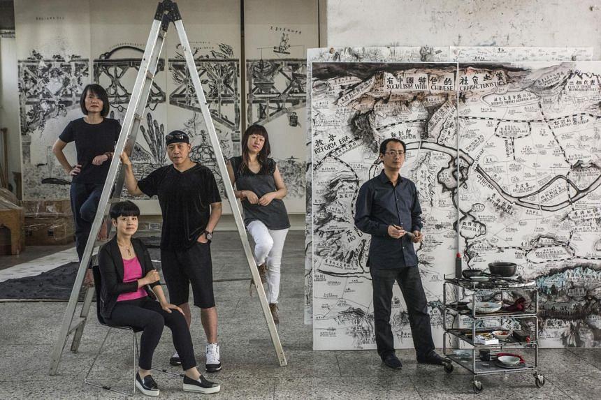 From left) Artists Kan Xuan, Yu Hong, Sun Yuan, Peng Yu and Qiu Zhijie at a Beijing studio, Sept. 9, 2017. All five are in the Guggenheim exhibition.