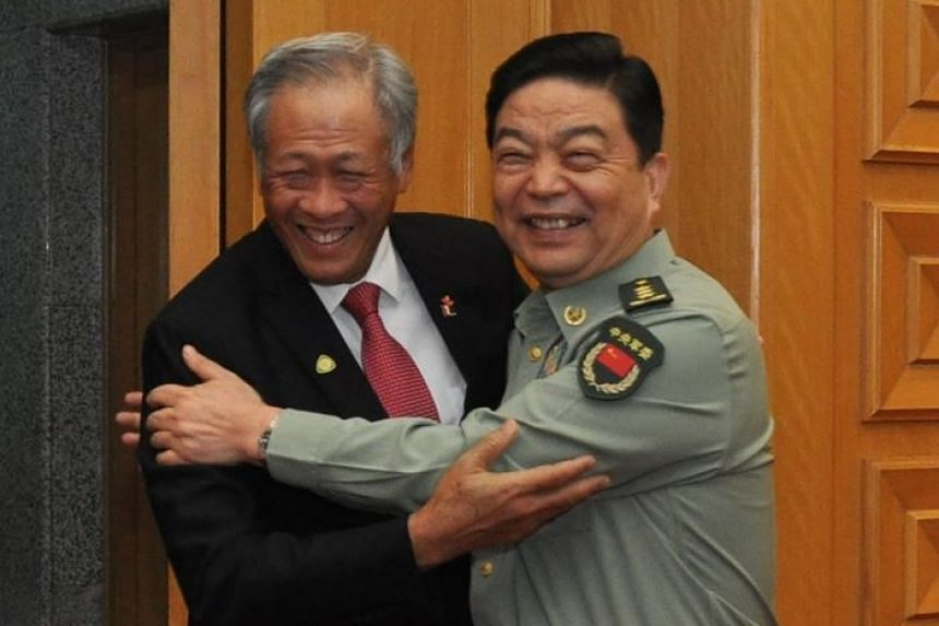 Singapore's Defence Minister Ng Eng Hen with Chinese State Councillor and Minister of National Defence General Chang Wanquan.