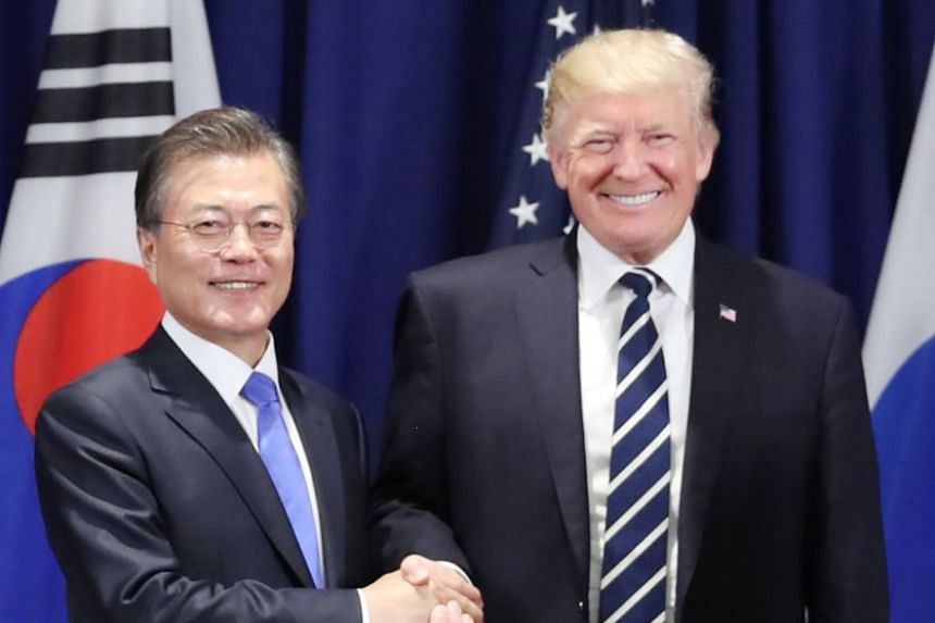 Moon (left) and Trump shake hands as they meet for summit talks on the sidelines of the UN General Assembly.