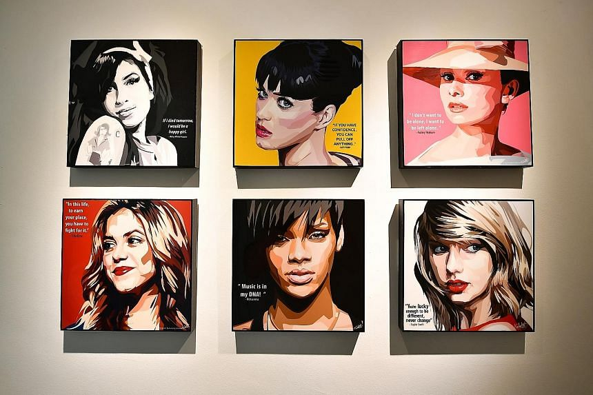 Ms Jessica Koh's five-room HDB flat has plenty of wooden surfaces and a glass-enclosed kitchen, while pop art representations of cultural icons, such as Katy Perry, Rihanna and Taylor Swift (above), lend a funky touch.